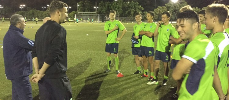 Team Pic - Celtic Players listening other angle