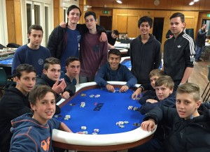 The u15s team prior to the start of the poker night